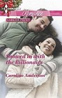 Snowed in with the Billionaire  (large print)
