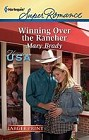Winning Over the Rancher  (large print)
